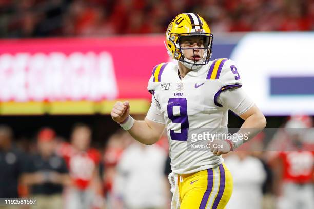 Joe Burrow of the LSU Tigers celebrates after throwing a touchdown pass to Terrace Marshall Jr #6 in the third quarter against the Georgia Bulldogs...
