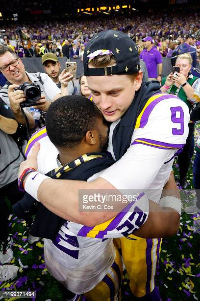 Joe Burrow of the LSU Tigers celebrates with Clyde EdwardsHelaire of the LSU Tigers after defeating the Clemson Tigers 4225 in the College Football...