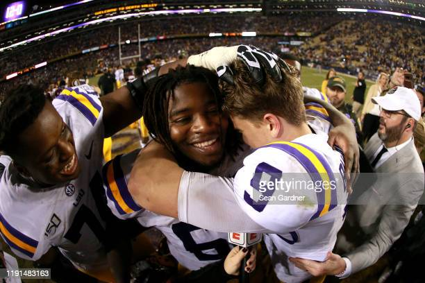 Joe Burrow of the LSU Tigers celebrates with Damien Lewis of the LSU Tigers after his team defeated the Texas AM Aggies at Tiger Stadium on November...