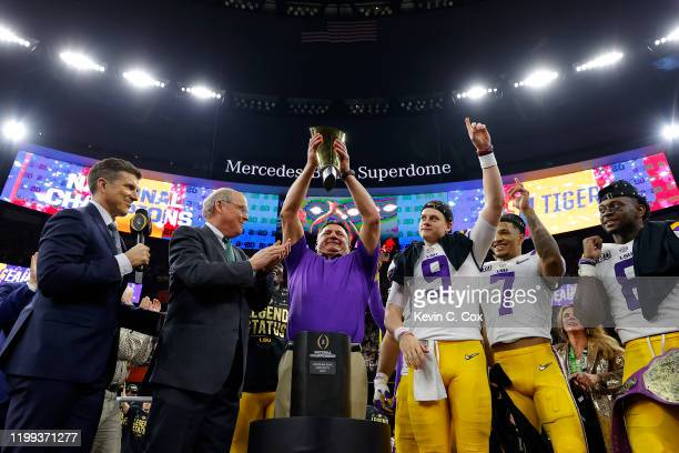 Joe Burrow of the LSU Tigers celebrates with head coach Ed Orgeron of the LSU Tigers after defeating the Clemson Tigers 4225 in the College Football...
