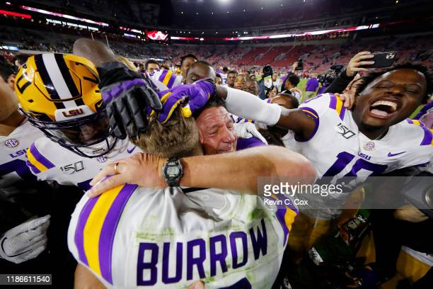 Joe Burrow of the LSU Tigers celebrates with head coach Ed Orgeron after defeating the Alabama Crimson Tide 4641 at BryantDenny Stadium on November...