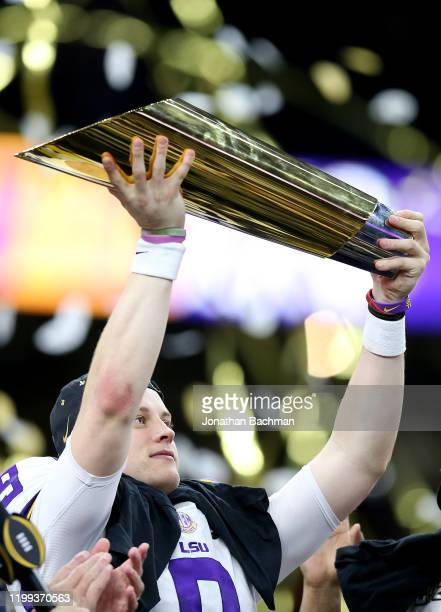 Joe Burrow of the LSU Tigers celebrates with the trophy after defeating the Clemson Tigers 4225 in the College Football Playoff National Championship...