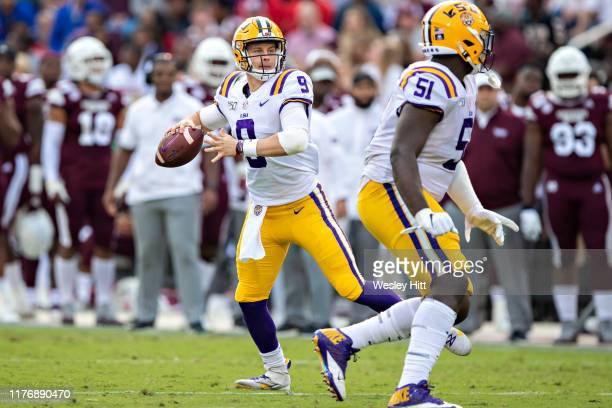 Joe Burrow of the LSU Tigers drops back to pass during a game against the Mississippi State Bulldogs at Davis Wade Stadium on October 19 2019 in...