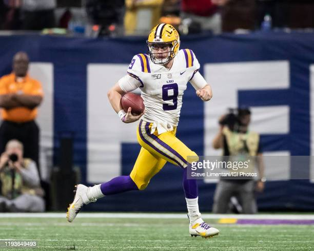 Joe Burrow of the LSU Tigers gets outside of the pocket for a run during a game between Georgia Bulldogs and LSU Tigers at Mercedes Benz Stadium on...