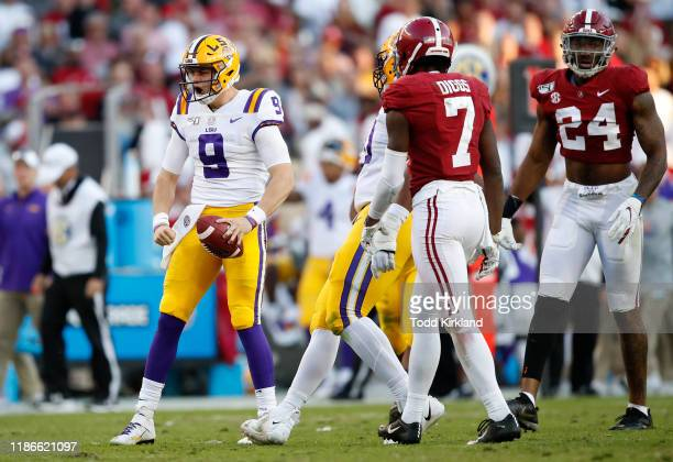 Joe Burrow of the LSU Tigers reacts during the first half against the Alabama Crimson Tide in the game at BryantDenny Stadium on November 09 2019 in...
