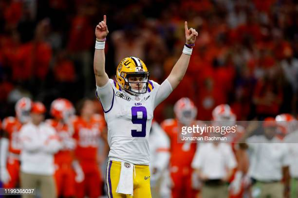 Joe Burrow of the LSU Tigers reacts to a touchdown against Clemson Tigers during the third quarter in the College Football Playoff National...