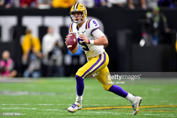 Joe Burrow of the LSU Tigers rolls out of the pocket during the second quarter of the College Football Playoff National Championship game against the...