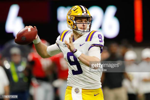 Joe Burrow of the LSU Tigers throws a pass in the first half against the Georgia Bulldogs during the SEC Championship game at MercedesBenz Stadium on...