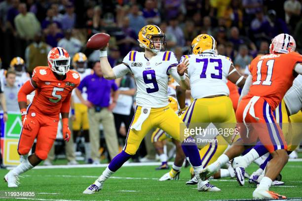 Joe Burrow of the LSU Tigers throws a pass under pressure during the first half against Clemson Tigers in the College Football Playoff National...