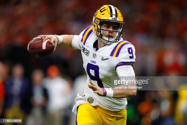 Joe Burrow of the LSU Tigers throws the ball under pressure against the Clemson Tigers during the College Football Playoff National Championship game...