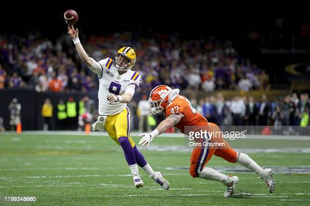 Joe Burrow of the LSU Tigers throws the ball under pressure as James Skalski of the Clemson Tigers tries to defend during the College Football...