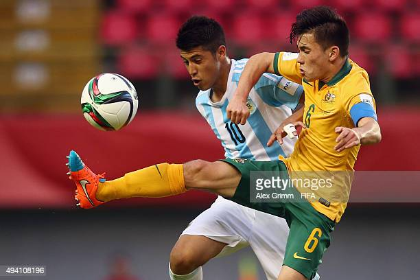 Joe Caletti of Australia is challenged by Exequiel Palacios of Argentina during the FIFA U17 World Cup Chile 2015 Group C match between Argentina and...