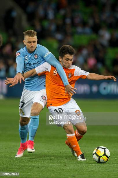 Joe Caletti of the Brisbane Roar and Marcin Budzinski of Melbourne City contest the ball during Round 1 of the Hyundai ALeague Series between...