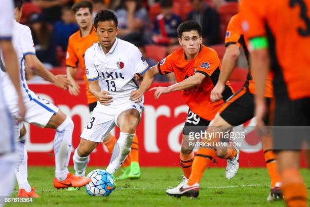 Joe Caletti of the Brisbane Roar fights for the ball with Atsutaka Nakamura of the Kashima Antlers during the AFC Champions League Group football...