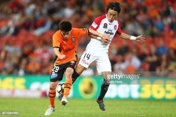 Joe Caletti of the Roar and Jumpei Kusukami of the Wanderers compete for the ball during the ALeague Elimination Final match between the Brisbane...