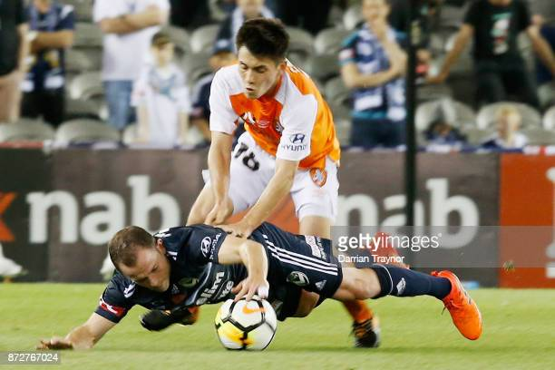 Joe Caletti of the Roar and Leigh Broxham of the Victory collide during the round six ALeague match between the Melbourne Victory and Brisbane Roar...