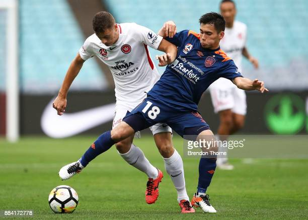 Joe Caletti of the Roar competes with Oriol Riera of the Wanderers during the round nine ALeague match between the Western Sydney Wanderers and the...