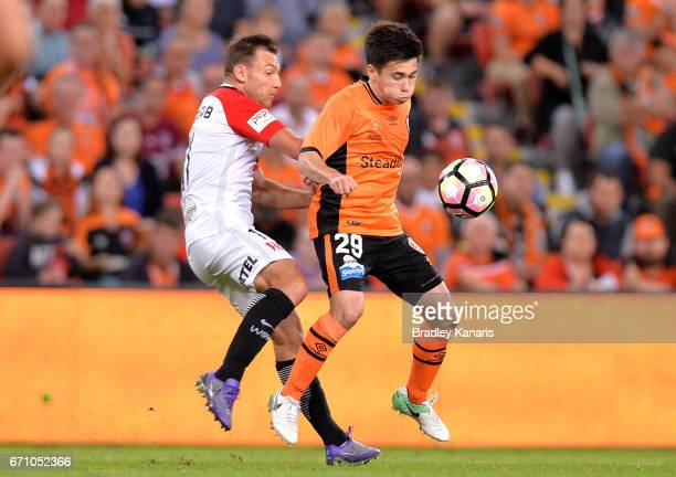 Joe Caletti of the Roar is challenged by Brendan Santalab of the Wanderers during the ALeague Elimination Final match between the Brisbane Roar and...