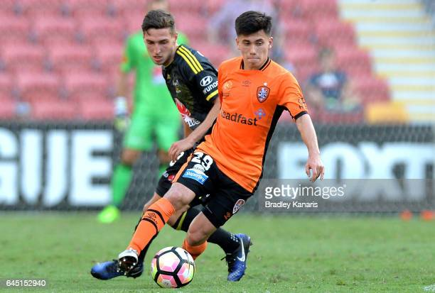 Joe Caletti of the Roar is pressured by the defence during the round 21 ALeague match between the Brisbane Roar and the Wellington Phoenix at Suncorp...