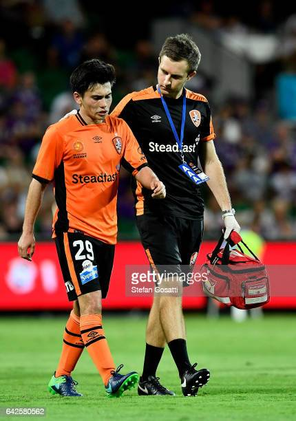 Joe Caletti of the Roar leaves the ground after injuring his leg during the round 20 ALeague match between Perth Glory and Brisbane Roar at nib...