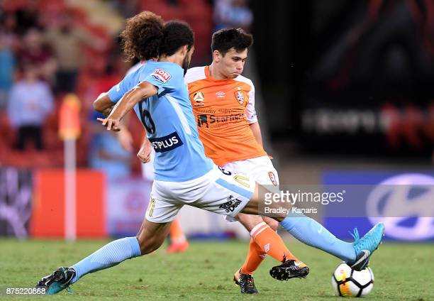 Joe Caletti of the Roar takes on the defence of Osama Malik of Melbourne City during the round seven ALeague match between Brisbane Roar and...
