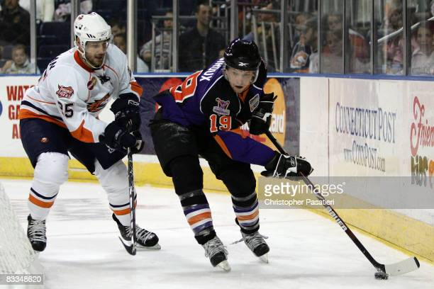 Joe Callahan of the Bridgeport SoundTigers challenges Claude Giroux of the Philadelphia Phantoms for possession of the puck by during the second...
