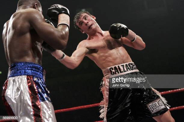 Joe Calzaghe connects with a hook against Jeff Lacy during the WBO and IBF super middleweight unification title fight at the MEN Arena on March 5,...