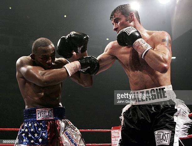 Joe Calzaghe exchanges punches with Jeff Lacy during the WBO and IBF super middleweight unification title fight at the MEN Arena on March 5, 2006 in...
