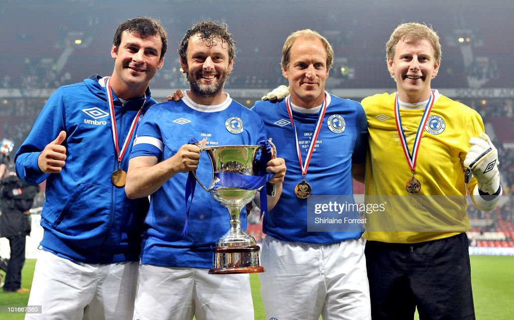 Joe Calzaghe, Michael Sheen, Woody Harrelson and Patrick Kielty pose with the trophy at Soccer Aid in aid of UNICEF at Old Trafford on June 6, 2010 in Manchester, England.