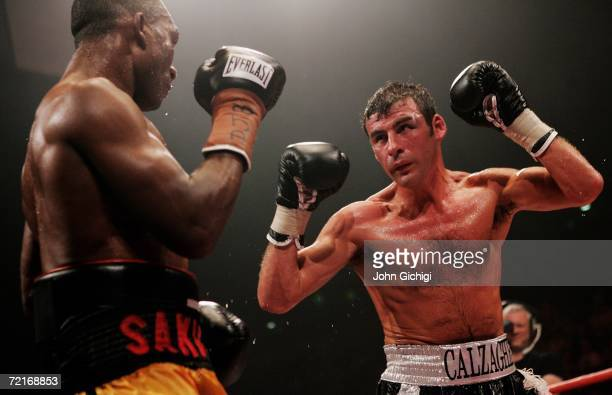 Joe Calzaghe of Wales exchanges punches with Sakio Bika of Australia during the WBO and IBF super middleweight title fight at the MEN Arena on...