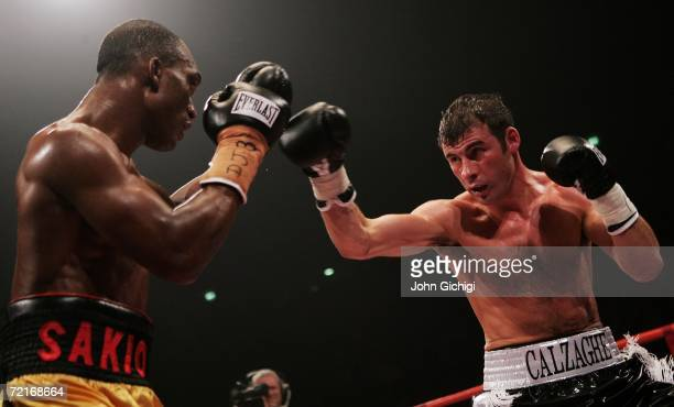 Joe Calzaghe of Wales exchanges punches with Sakio Bika of Sydney during the WBO and IBF super middleweight title fight at the MEN Arena on October...