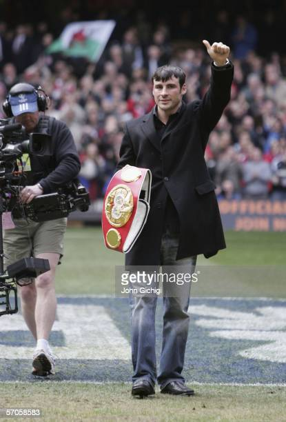 Joe Calzaghe the WBO and IBF boxing champion parades his belt before the RBS Six Nations match between Wales and Italy at the Millenium Stadium on...