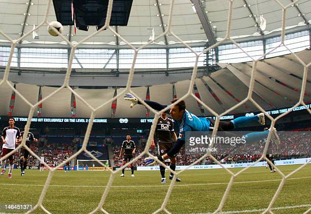 Joe Cannon of the Vancouver Whitecaps FC dives to make a save off a Colorado Rapids shot during their MLS game June 16 2012 in Vancouver British...