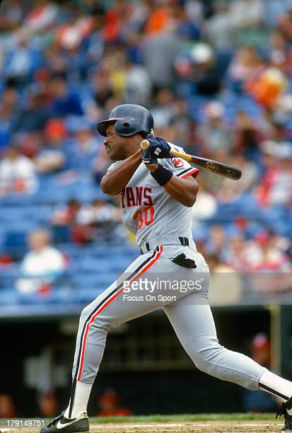 Joe Carter of the Cleveland Indians bats against the Baltimore Orioles during an Major League Baseball game circa 1988 at Memorial Stadium in...