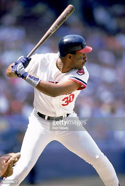 Joe Carter of the Cleveland Indians swings at the pitch during a season game Joe Carter played for the Cleveland Indians from 19841989