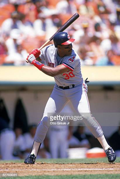 Joe Carter of the Cleveland Indians waits for the pitch during a 1988 game against the Oakland Athletics at OaklandAlameda Coliseum in Oakland...