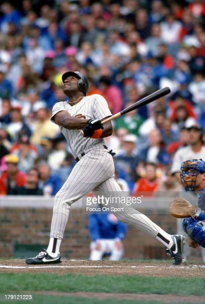Joe Carter of the San Diego Padres bats against the Chicago Cubs during an Major League Baseball game circa 1990 at Wrigley Field in Chicago Illinois...