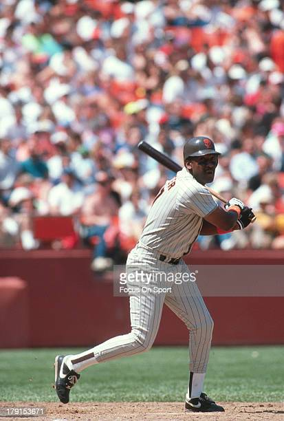 Joe Carter of the San Diego Padres bats against the San Francisco Giants during an Major League Baseball game circa 1990 at Candlestick Park in San...