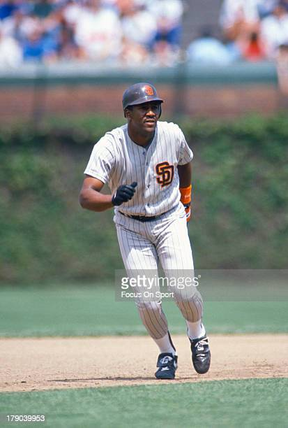 Joe Carter of the San Diego Padres leads off of second base against the Chicago Cubs during an Major League Baseball game circa 1990 at Wrigley Field...