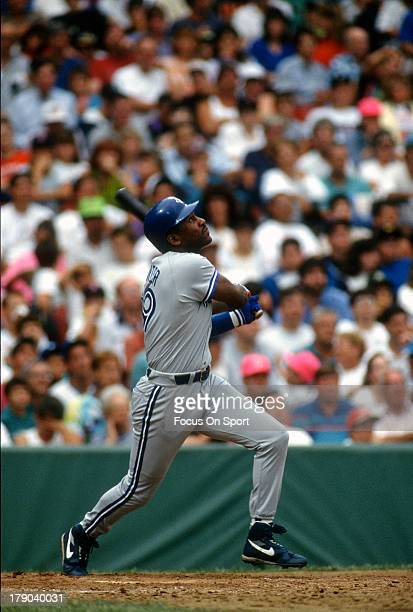 Joe Carter of the Toronto Blue Jays bats against the Boston Red Sox during an Major League Baseball game circa 1991 at Fenway Park in Boston...