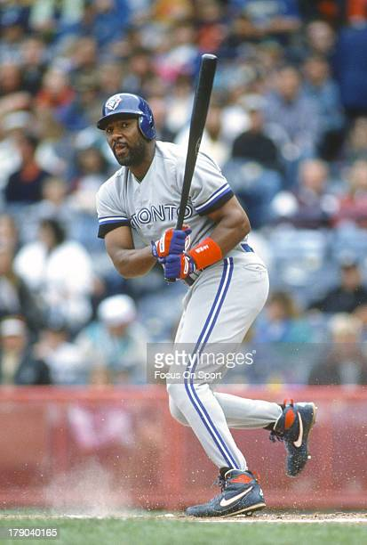Joe Carter of the Toronto Blue Jays bats against the Milwaukee Brewers during an Major League Baseball game circa 1995 at Milwaukee County Stadium in...