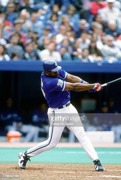 Joe Carter of the Toronto Blue Jays bats during an Major League Baseball game circa 1996 at Exhibition Stadium in Toronto Ontario Carter played for...