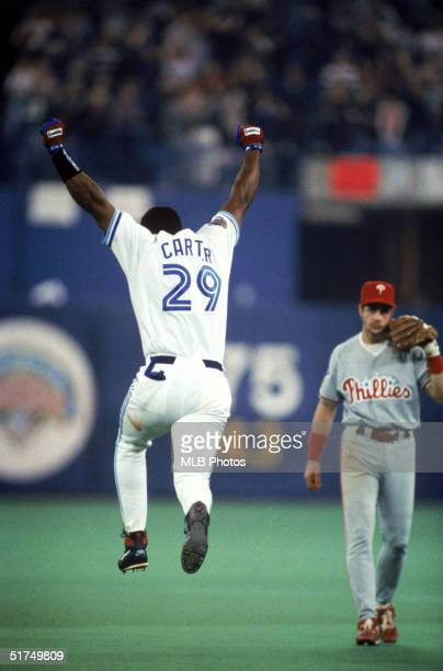 Joe Carter of the Toronto Blue Jays celebrates after hitting a threerun home run off of pitcher Mitch Williams of the Philadelphia Phillies to win...