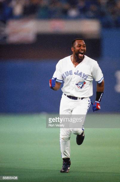 Joe Carter of the Toronto Blue Jays celebrates his home run during game six of the 1993 World Series against the Philadelphia Phillies at the Skydome...