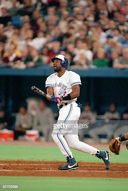 Joe Carter of the Toronto Blue Jays hits a solo home run against the Atlanta Braves in the fourth inning of game three of the 1992 World Series at...