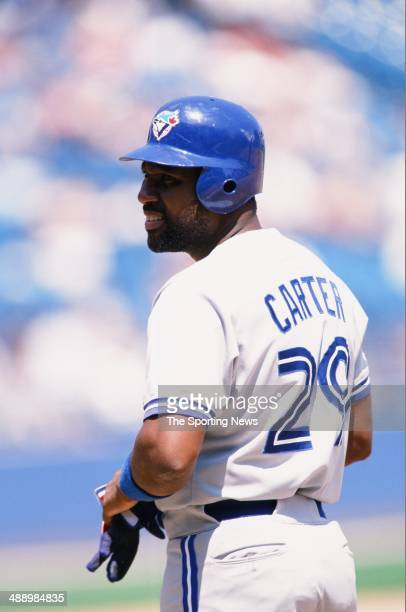Joe Carter of the Toronto Blue Jays looks on against the Chicago White Sox at Comiskey Park in Chicago Illinois on May 22 1996 The White Sox defeated...