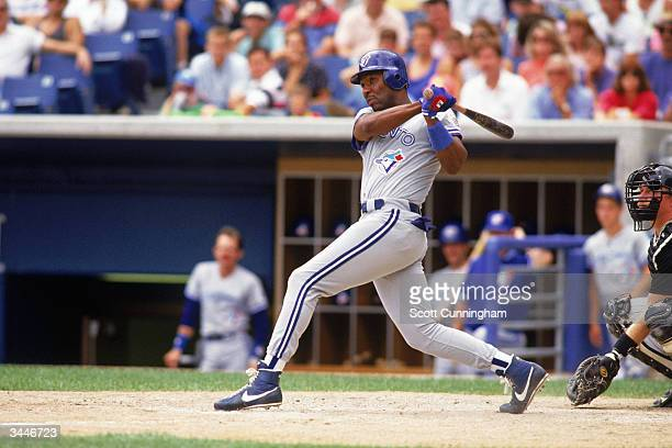 Joe Carter of the Toronto Blue Jays swings at a pitch during a game circa 199197