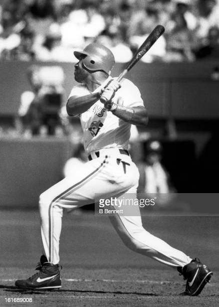 Joe Carter of the Toronto Blue Jays swings at a pitch during an MLB game circa 1993 at the Toronto Skydome in Toronto Ontario Canada