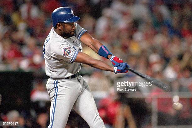 Joe Carter of the Toronto Blue Jays swings at a pitch during Game five of the 1993 World Series against the Philadelphia Phillies at Veterans Stadium...