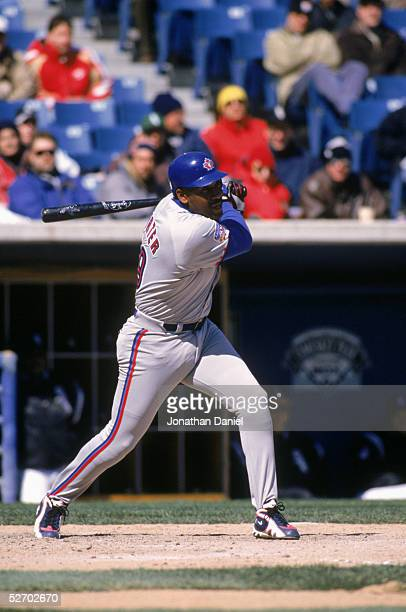 Joe Carter of the Toronto Blue Jays swings at the pitch during the game against the Chicago White Sox at the New Comiskey Park on April 9 1997 in...